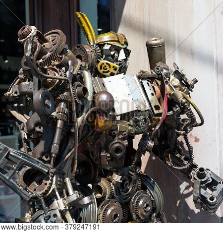Robot Made Of Metal Parts And Assemblies. Metal Components And Parts Are Arranged In Shape Of A Robo