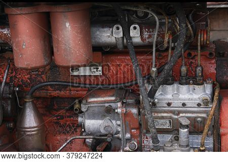 Old Diesel Tractor Engine Close-up, Red And Rusty
