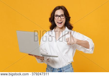 Cheerful Young Business Woman In White Shirt Glasses Isolated On Yellow Background Studio. Achieveme
