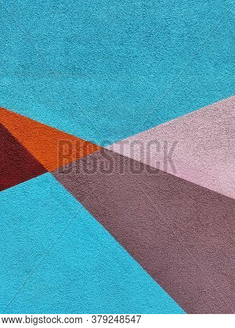 Brightly Colored Light Blue Wall With Stucco Texture And Geometric Pattern