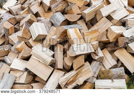 Preparation Of Firewood For Winter. Rural Cozy Firewood Background. Dry Chopped Firewood Logs In Pil