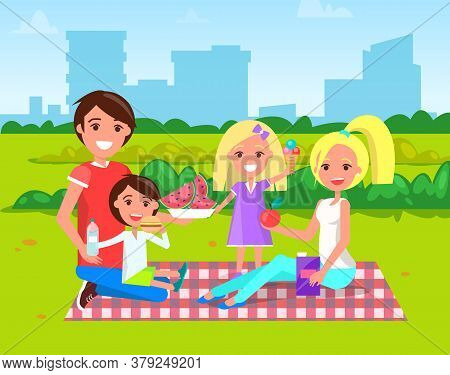Family Have Picnic On Blanket In City Park. Father Playing With Son And Daughter Eating Ice Cream. M
