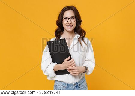 Smiling Young Brunette Business Woman In White Shirt Glasses Isolated On Yellow Background Studio. A