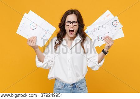 Angry Irritated Young Brunette Business Woman In White Shirt Glasses Isolated On Yellow Wall Backgro