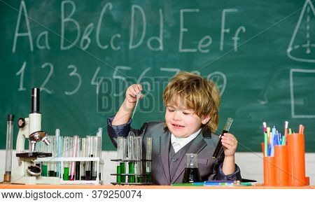 In Searching Of New Professional Solutions. Little Boy In The Laboratory. Biology Education Of Littl