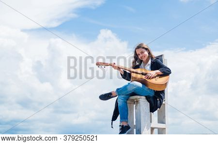 Music School Classes. Small Guitar Player On Sky Background. Country Music Style. String Musical Ins