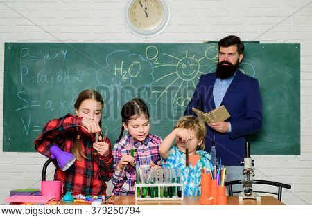 Science Is Our Life. Doing Experiments With Liquids In Chemistry Lab. Chemistry Lab. Happy Children