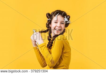 Child Fashion Model Concept. Childhood Happiness. Beauty And Fashion. Child Making Hairstyle. Little