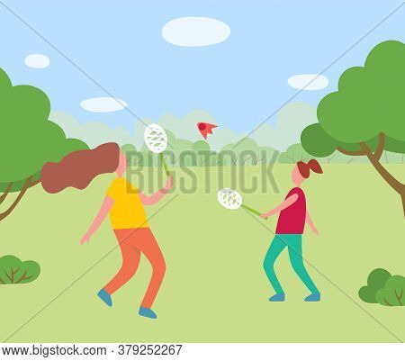 Two Girls Playing Together In Park Or Forest. Badminton Racquet Sport Played Using Racquets To Hit S