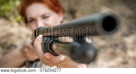 Woman Shooting With Pump Gun. Shotgun Front View Gun Point