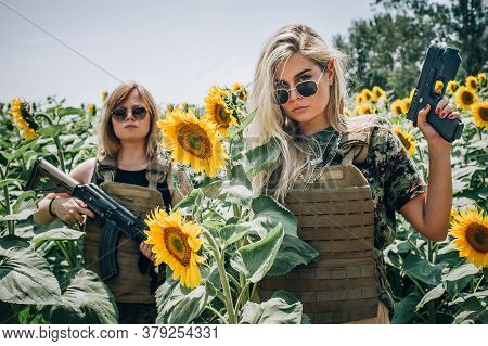 Military Team Of Attractive Female Soldiers With Gun And Rifle