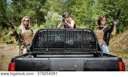 Female Military Security Team With Their Jeep. Woman With Weapon