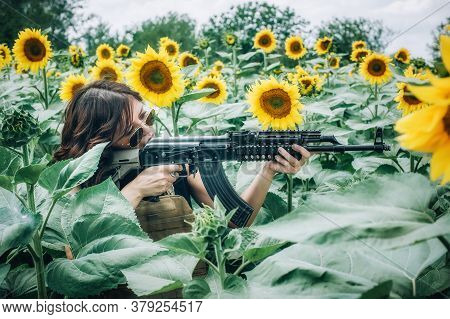 Beautiful And Attractive Woman Soldier With Rifle Machine Gun