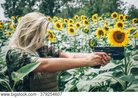 Attractive Female Army Soldier With Gun. Woman With Weapon