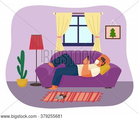 Man Using Phone Lying On Sofa Or Couch At Home. Guy Relaxing With Smartphone Lying On Pillow. Man Ti