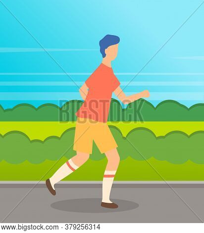 Young Sportive Guy Running At Road. Man Training To Run. Runner In T-shirt And Short Run Behind Mead