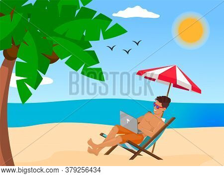 Young Stylish Guy Lying On Chair At Beach Near Sea Or Ocean. Man Wearing Sunglasses Relaxing Under U