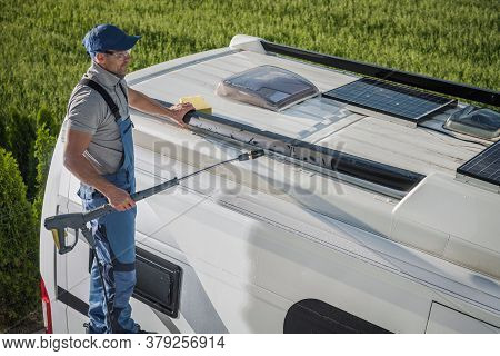 Smiling Caucasian Men In His 40s Washing His Rv Recreational Vehicle Motorhome Or Camper Van Using P