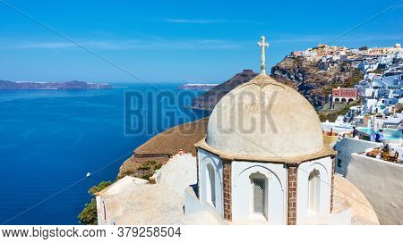 Panoramic view of Santorini island with ancient greek church on the coast in Fira (Thera) town, Greece