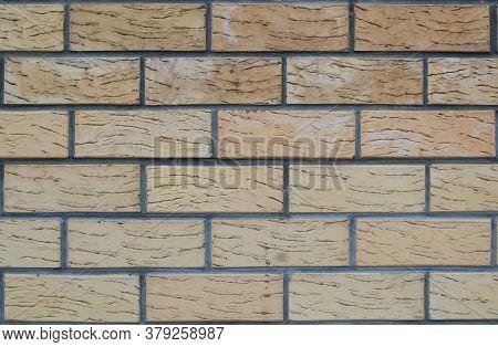 Brickwork Wall Of Light Brown Dark Cement Bricks
