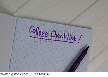 College Checklist Write On A Book Isolated Wooden Table.