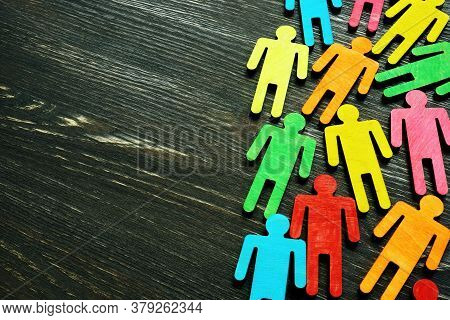 Diversity And Inclusion Background On The Dark Wooden Desk With Free Space.