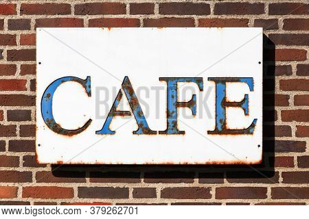 Cafe Sign On A Wall In Denmark