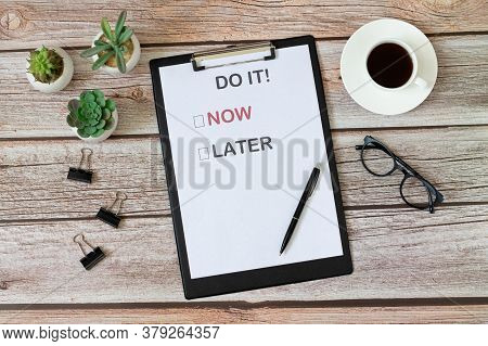 Office Desk With Motivation Poster Top View. Choose To Do It Now Or Later