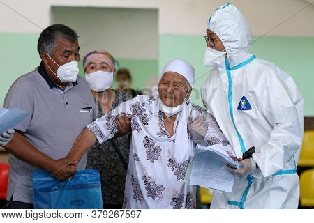 A Patients Get Help In The Temporary Covid-19 Care Center In Bishkek, On Jule 8, 2020. The Temporary