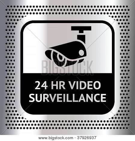 Video surveillance symbol on a metallic chromium background