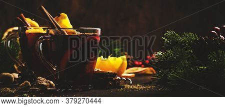 Xmas Hot Mulled Red Wine With Spices And Fruits On Wooden Rustic Table. Traditional Christmas Hot Dr
