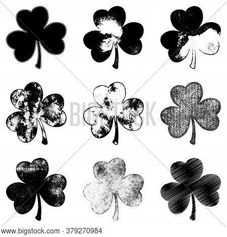 Set Of Clover Leaf In Grunge Style Isolated On A White Background. Distressed Patriks Day Shamrock D