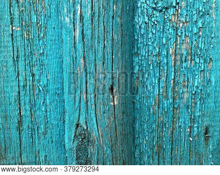 Old Grunge Wood With Blue Paint Peeling Off, Ideal For Background Or Texture. Peeled Blue Paint On W