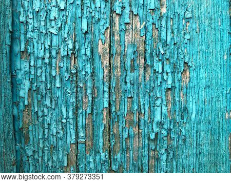 The Old Wooden Planks Of A Barn With Peeling Paint. Peeled Blue Paint On Wood Texture - Vintage Back