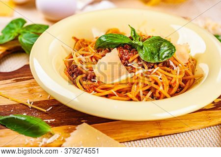 Spaghetti Bolognese With Minced Meat And Parmesan Cheese In Beige Plate