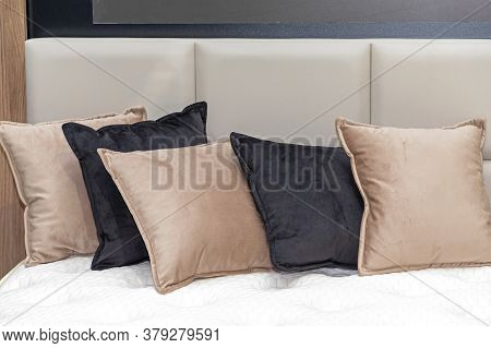Docorative Plush Pillows And Cushions In Bed