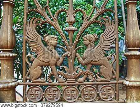 Decorative Metal Fence With Two Mythical Sphinxes Facing Each Other And A Swastika Border In Athens,