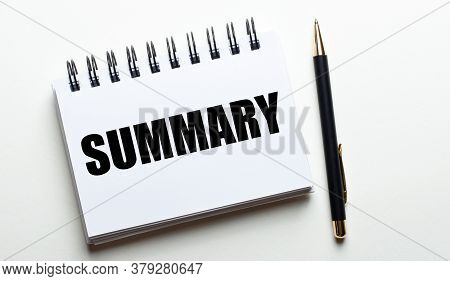 The Word Summary Is Written In A White Notebook Near A Black Pen On A White Background. Business Con