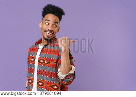 Side View Of Funny Young African American Guy In Casual Colorful Shirt Posing Isolated On Violet Bac