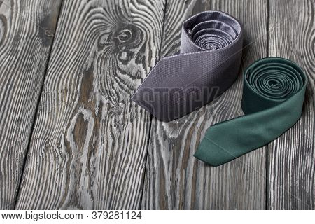 Two Men's Ties In Different Colors And Sizes. For Father And Son. Love And Togetherness Objects.