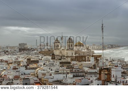 Aerial Dramatic Panoramic View Of The Old City, Rooftops And Cathedral De Santa Cruz In Cloudy Day F