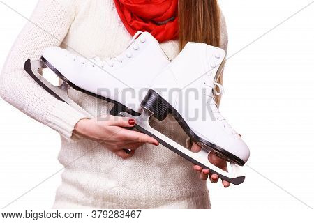 Woman With Ice Skates Getting Ready For Ice Skating, Winter Sport Activity. Girl Wearing White Wool