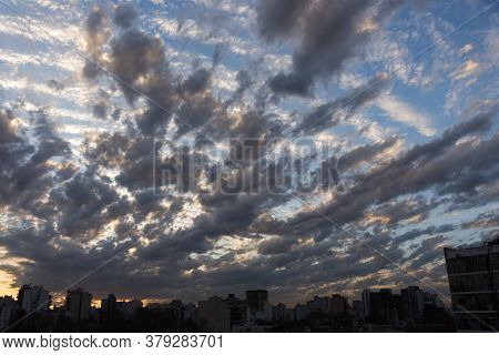 Skyline Of Buenos Aires, Argentina, With A Dramatic Sunset Sky. Dark Grey And White Clouds Over A Bl