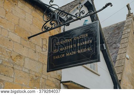 Broadway, Uk - July 07, 2020: Sign Outside Country Master Shop, Barber And Tailoring In Broadway, A