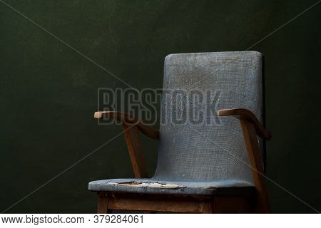 Old Blue Armchair On Green Background With Copy Space