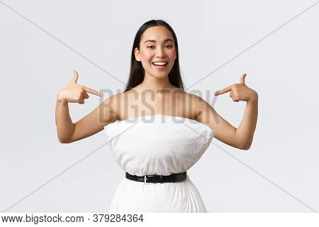 Good-looking Smiling Female Blogger Participate In Pillow Challenge, Secure Pillow With Belt Around