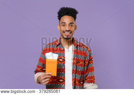 Smiling Young African American Guy In Casual Colorful Shirt Traveling Abroad Isolated On Violet Back