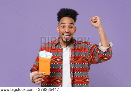 Happy African American Guy In Colorful Shirt Traveling Abroad Isolated On Violet Background. Air Fli