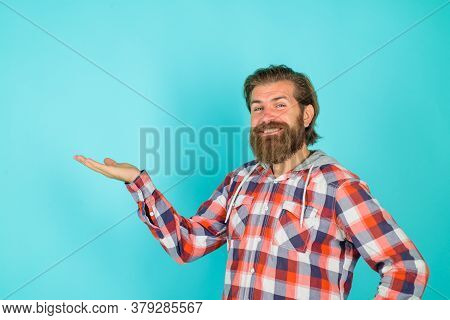 Smiling Bearded Man Shows Something. Advertising Content. Copy Space For Your Text. Look Attention.