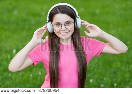 Girl Listening Summer Melody Wireless Headphones Nature Background, Favorite Playlist Concept.